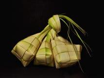Ketupat rice dumpling  on black background stock image