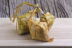 Ketupat Rice Dumpling and curry On wooden Background. Ketupat stock photography