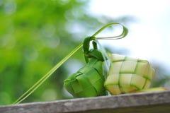 Ketupat rice dumpling  on green bokeh background