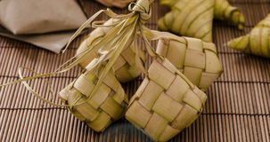 Ketupat or rice dumpling. Ketupat rice dumpling is a local delicacy during the festive season in South East Asia. Ketupat, a natural rice casing made from young stock video footage