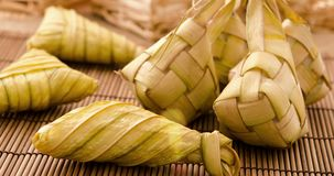 Ketupat or rice dumpling. Ketupat rice dumpling is a local delicacy during the festive season in South East Asia. Ketupat, a natural rice casing made from young stock footage