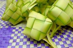 Ketupat or rice dumpling is Malaysian most iconic delicacy dish during eid mubarak Stock Images