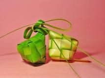 Ketupat rice dumpling  on pink background