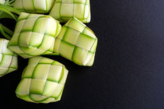 Ketupat Rice Dumpling Rice Casing. Rice dumpling casing or also know as ketupat made from coconut palm leaf on black background. Ketupat is a type of dumpling Royalty Free Stock Photography