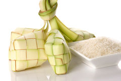 Ketupat rice dumpling and rice on traditional woven tray. Ketupat normally serve during serve during Hari Raya Aidilfitri in Malaysia and Indonesia Stock Images
