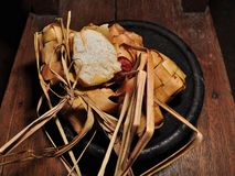 Ketupat rice dumpling  on wooden background stock image