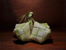 Ketupat rice dumpling  on wooden background royalty free stock photography