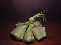 Ketupat rice dumpling  on wooden background