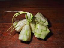 Ketupat rice dumpling  on wooden background royalty free stock photo