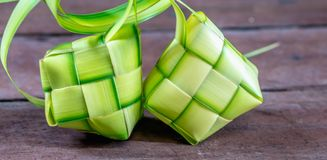 `Ketupat`: steamed rice wrapped with woven young palm leaf. traditional food from South East Asia stock image