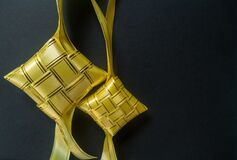 Free Ketupat. The Colorful Ribbons Of Ketupat With Dark Background Stock Photos - 182055283