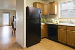 Keuken in een Bescheiden Huis Stock Foto