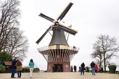 Keukenhof Lisse, The Netherlands - 21 March , 2019: Tourists on background of old dutch windmill, symbol of Holland. Keukenhof Lisse, The Netherlands - 21 March royalty free stock images