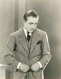 Keurige mens in drie-stuk kostuum stock afbeelding