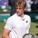 Kevin Anderson, South African player, holding his plate on centre court as runner up in the Wimbledon mens finals. Wimbledon Lawn Tennis Championships, London royalty free stock images