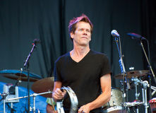 Kevin Bacon performing with The Bacon Brothers Stock Photo