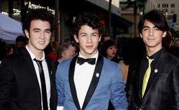 Kevin Jonas, Joe Jonas and Nick Jonas. Kevin Jonas, Nick Jonas and Joe Jonas at the World Premiere of `Jonas Brothers: The 3D Concert Experience` held at the El Royalty Free Stock Photo