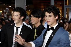 Kevin Jonas, Joe Jonas and Nick Jonas. At the World Premiere of `Jonas Brothers: The 3D Concert Experience` held at the El Capitan Theater in Hollywood Royalty Free Stock Photos