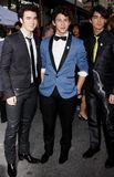 Kevin Jonas, Joe Jonas and Nick Jonas. Kevin Jonas,Nick Jonas and Joe Jonas at the World Premiere of `Jonas Brothers: The 3D Concert Experience` held at the El Royalty Free Stock Image