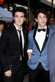 Kevin Jonas and Nick Jonas. At the World Premiere of `Jonas Brothers: The 3D Concert Experience` held at the El Capitan Theater in Hollywood, California, United Royalty Free Stock Photography