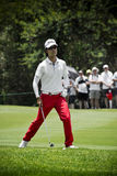 Kevin Na. Clubbing the ball up the fairway, heading to the green, on the 4th day of the tournament Royalty Free Stock Photography