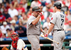 Kevin Youkilis. Boston Red Sox third baseman Kevin Youkilis is greeted by JD Drew after hitting a home run in Philadelphia Royalty Free Stock Images