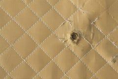 Kevlar bulletproof ves, background. Hit shot 9mm in Kevlar bulletproof ves, background Stock Photo