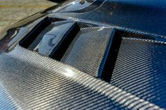 Kevlar carbon fiber texture on a car hood. Various vehicle details in Southern California Stock Photography