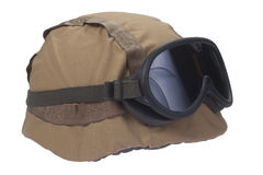 Kevlar helmet with camouflage cover and protective goggles Stock Photos