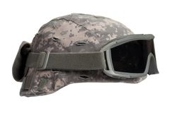 Kevlar helmet with camouflage cover and protective goggles Royalty Free Stock Photography