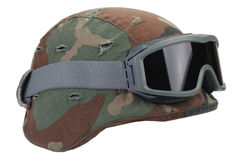 Kevlar helmet with a camouflage cover and protective goggles Royalty Free Stock Photo