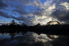 Kew Gardens, London, Main Palm House GreenHouse, GlassHouse, Winter Sunset and Sky Stock Images