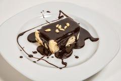 Kexet med choklad och sörjer muttrar arkivfoton