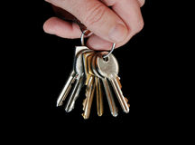 Key 07. Hand with keys on black background Royalty Free Stock Images