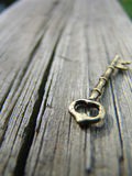 Key #1. Vintage Key on aged wood Royalty Free Stock Photo