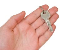 Key 1. Hand with key on white background, clipping path embedded royalty free stock photo