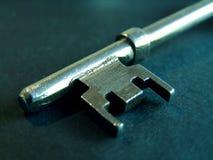 Key. Closeup of old worn key with colour tint stock photos