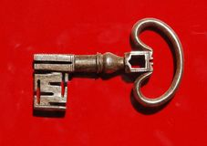Key. Old key on red velvet, en the Cathedral of Segovia, Spain Stock Image