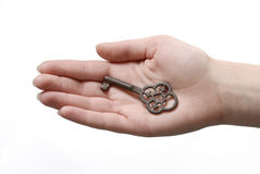 Key. Hand is holding an old key Stock Images