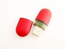 Key. Red USB connector on the white fone Royalty Free Stock Image