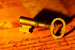 Key. Photo of a Vintage Key and Letters Stock Photo