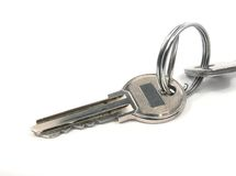Key. From the house. It is partially visible on a picture and the second  which is connected to the first by ring Stock Image