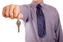 Key. Businessman holding a key, could be used for successful business or real estate concept royalty free stock photography