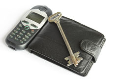 Key. Black purse and key and mobile phone Stock Image