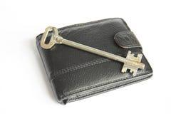 Key. Black purse and key. Isolated Royalty Free Stock Image