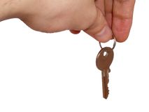 Key 3. Hand with key on white background, clipping path embedded stock photos