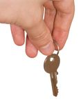 Key 4. Hand with key on white background, clipping path embedded royalty free stock image