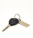 Key. Pilot with car key over white background stock photography