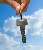 Key. In hand over blue sky Royalty Free Stock Images