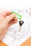 Key. Holding the key of new home Royalty Free Stock Images